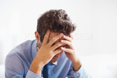 Buy stock photo Close up of businessman holding hands up to face