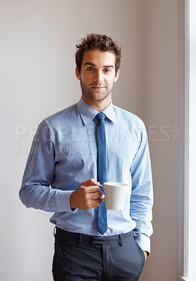 Buy stock photo Executive standing next to window with cup of coffee