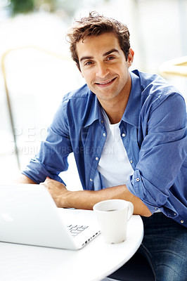 Buy stock photo Portrait of smart young man sitting outside with a computer laptop and smiling