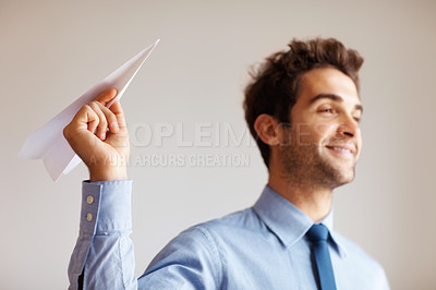 Buy stock photo Executive holding paper airplane indoors