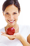 Health concept - Woman with a red apple in hand on white