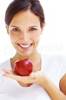 Buy stock photo Portrait of lovely young girl with a red apple in hand over white background