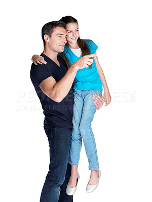 Buy stock photo Portrait of a handsome young man showing something interesting to his daughter against white background