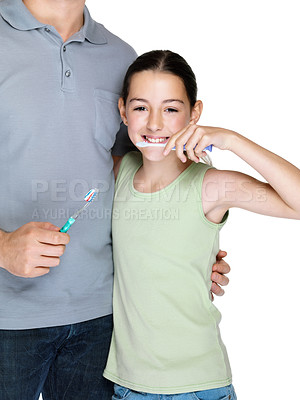 Buy stock photo Portrait of a cute little girl brushing her teeth with her father against white background