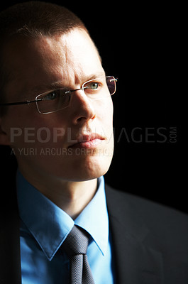 Buy stock photo Young Businessman full of ideas looking out of window