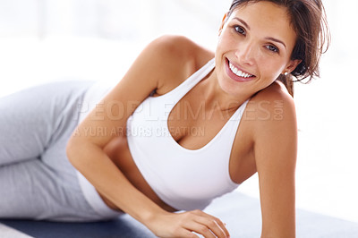 Buy stock photo Portrait of gorgeous young female smiling while lying on yoga mat