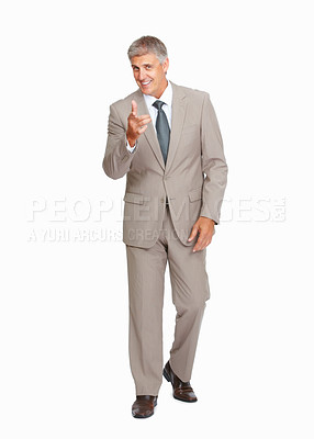 Buy stock photo Studio shot of a mature businessman pointing at you against a white background