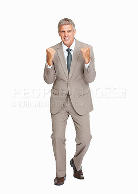 Buy stock photo Studio shot of a mature businessman enjoying victory against a white background