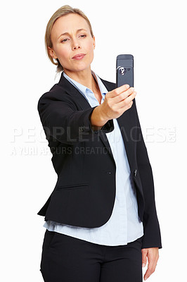 Buy stock photo Portrait of business woman clicking photos using her mobile phone on white background