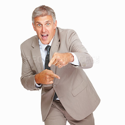 Buy stock photo Studio shot of a successful mature businessman gesturing against a white background