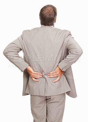 Buy stock photo Studio shot of a businessman suffering from backache against a white background