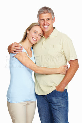 Buy stock photo Portrait of happy and beautiful couple embracing over white background