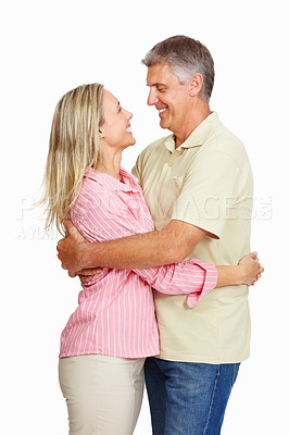 Buy stock photo Portrait of affectionate mature couple hugging each other over white background