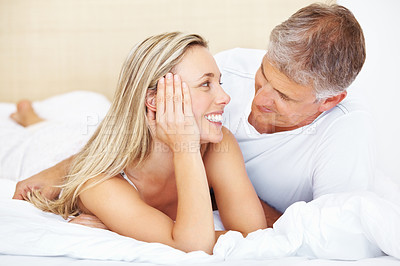 Buy stock photo Portrait of mature couple relaxing in their bed at home