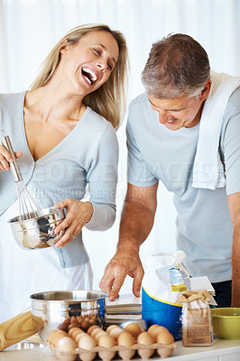 Buy stock photo Portrait of happy couple spending time together in kitchen at home