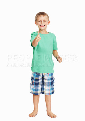 Buy stock photo Full length of young boy gesturing thumbs up sign over white background