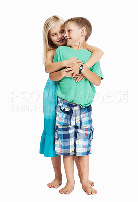 Buy stock photo Full length of young girl hugging boy from behind on white background