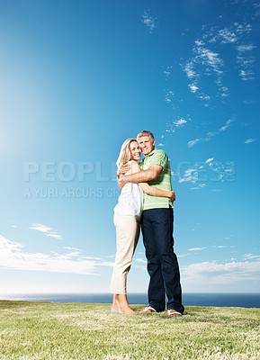 Buy stock photo Full length of loving mature couple embracing each other at park