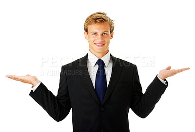 Buy stock photo Studio shot of a young business man gesturing at copyspace isolated on white