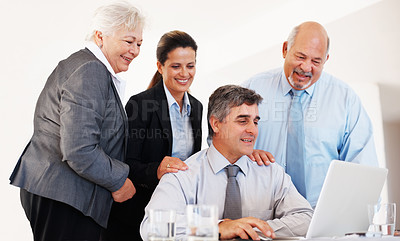 Buy stock photo Group of four happy business people in meeting at office using laptop