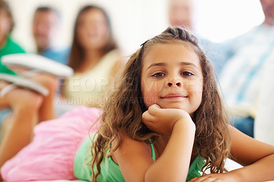 Buy stock photo Closeup portrait of a relaxed sweet girl with family sitting in the background