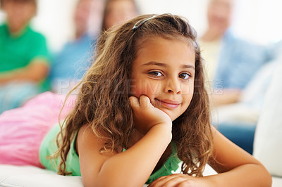 Buy stock photo Closeup portrait of a cute girl relaxing with family sitting in the background