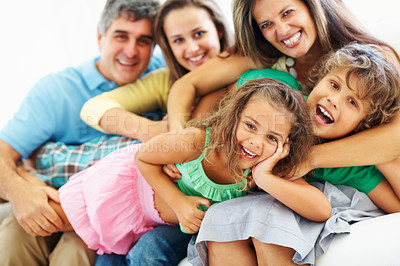 Buy stock photo Portrait of happy parents with laughing children having a great time together