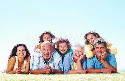 Buy stock photo Portrait of cheerful Caucasian family lying on grass - copyspace