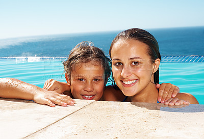 Buy stock photo Closeup of two siblings resting on the edge of swimming pool smiling at you on a sunny summer day