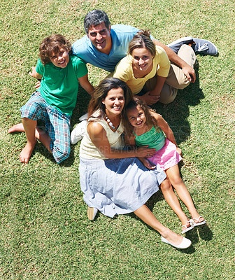Buy stock photo Top view of a mature couple with their children sitting on grass