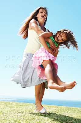 Buy stock photo Full length of mother and her daughter playing together at a meadow