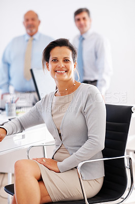 Buy stock photo Portrait of successful business woman in office chair with colleagues in background