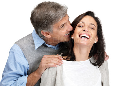 Buy stock photo Portrait of a happy mature man and his beautiful wife sharing secret on white background