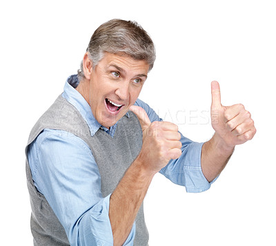 Buy stock photo Portrait of an attractive mature man showing thumbs up sign against white background