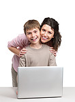 Cute little boy and his mother with a laptop