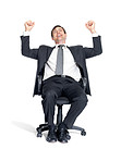 Excited businessman sitting on chair and celebrating success