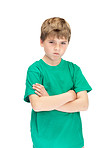 Cute little boy with an angry expression on white