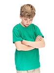 Sad little boy standing with folded hands on white