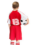 Defeat - Rear view of a small child with soccer ball