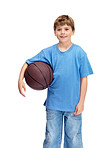 Happy small boy holding basketball