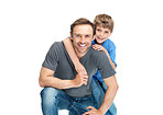 Happy young man with his son smiling on white background