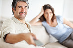 Mature couple relaxing at home and watching tv