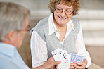 Enjoying retirement - Old couple playing cards