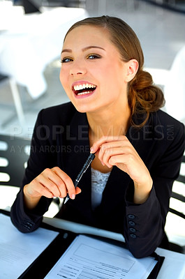 Buy stock photo Portrait of a happy young businesswoman looking through paperwork