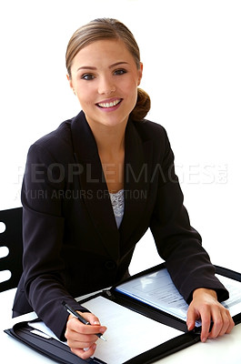 Buy stock photo Shot of a young businesswoman looking through paperwork