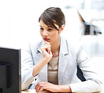Female business executive thinking while working at office