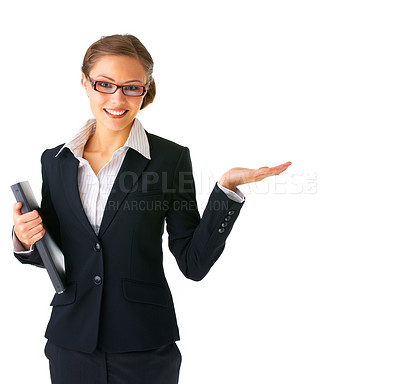 Buy stock photo Portrait of a beautiful young businesswoman, holding out her hand as displaying something. Ready for you to add text.
