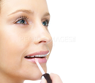 Buy stock photo Cropped closeup image of a female applying lipstick against white