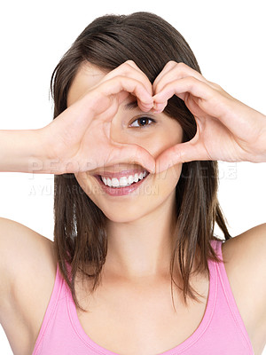 Buy stock photo Cute young female making a heart shape with hands against white