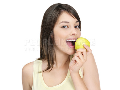 Buy stock photo Portrait of a cute young female biting a green apple isolated against white